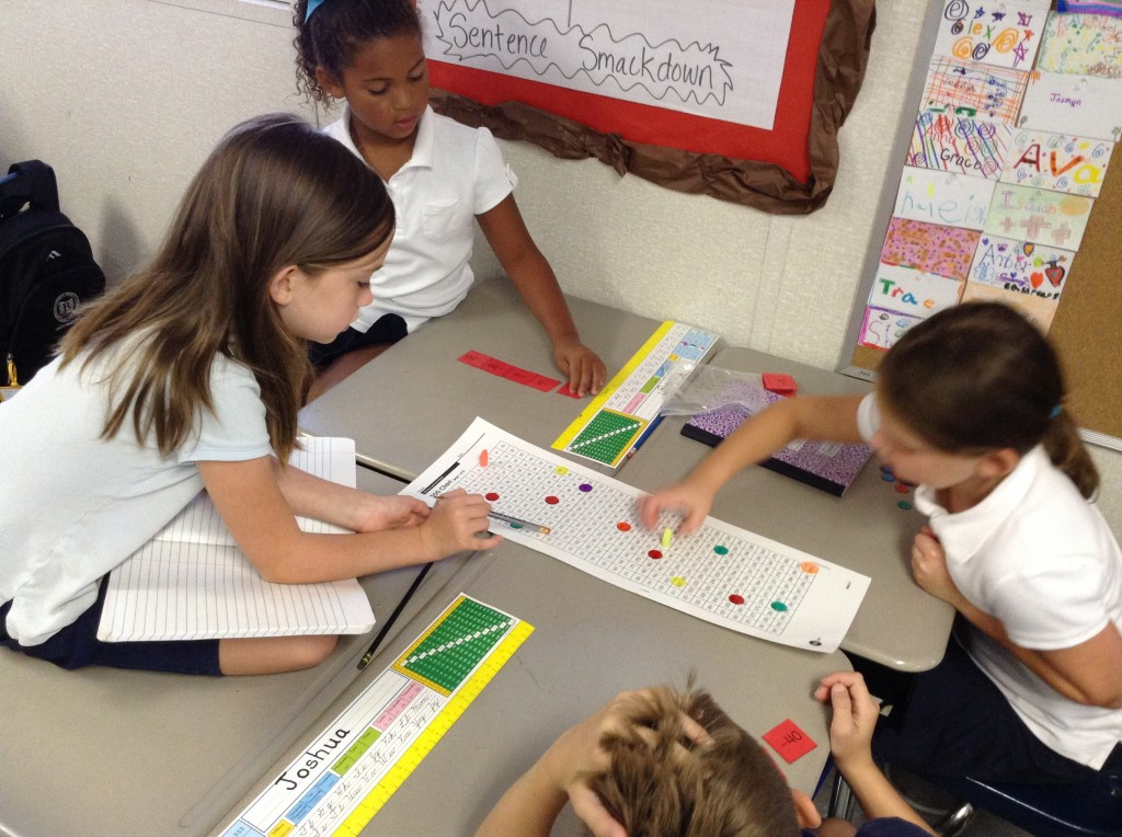Kelly, Kaleigh, Amber, and Joshua navigate their way through the addition and subtraction hurdles of Capture 5.